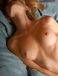 Jaw-dropping youthfull blond with unerring tit coupled with lengthy hair undresses her milky t-shirt coupled with linger naked on the green bed.