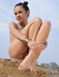 Erotic, voluptuous poses in the midst of a barren, exotic landscape.