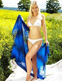 Sunbathing bombshell in an ultra gorgeous two-piece bikini.
