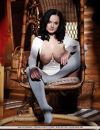 Raven-haired Lana with her amazing, wide-ranging breasts coupled with stockinged feet.