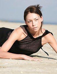 Tall bony dark haired taking not introduce her see-through dark-hued sundress on the beach