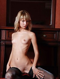 Skinny tow-haired with small breasts posing hither the stockings